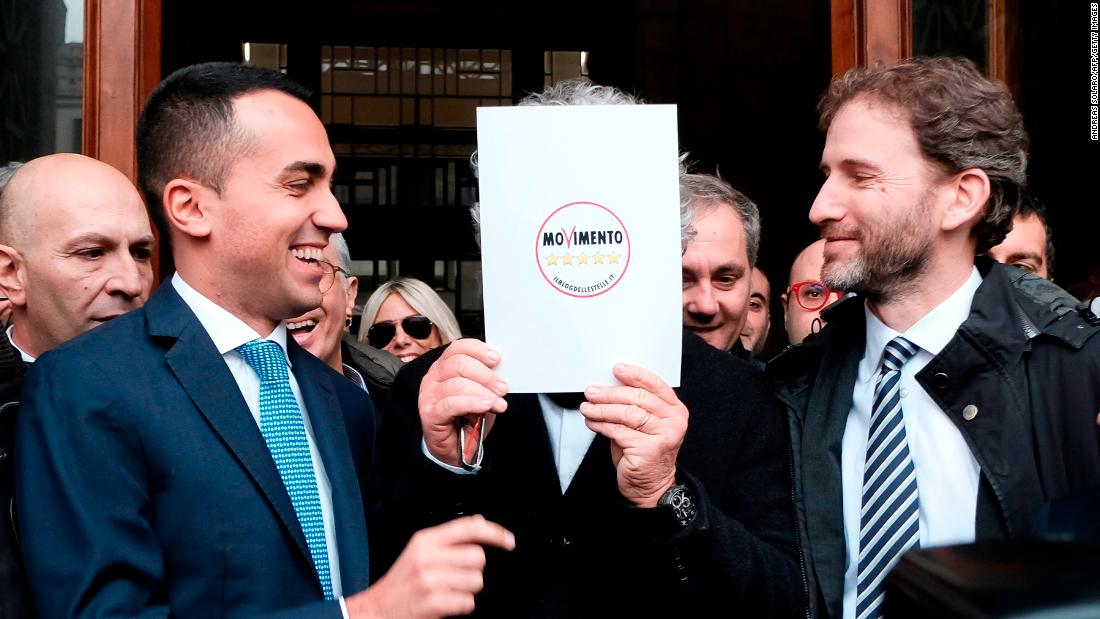 Luigi Di Maio (L) jokes with M5S founders Beppe Grillo (hidden) and Davide Casaleggio (R) in January.