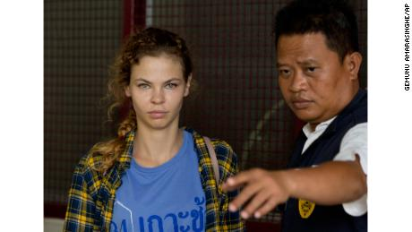 A police officer escorts Anastasia Vashukevich from a detention center in Pattaya, south of Bangkok, Thailand, Wednesday, Feb. 28, 2018.