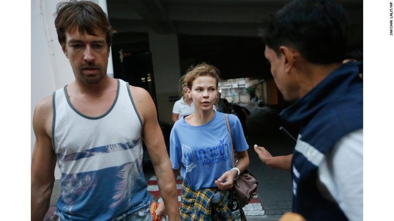 Anastasia Vashukevich, center, and Alexander Kirillov, left, arrive at the immigration detention center in Bangkok on February 28.
