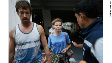Anastasia Vashukevich, center, and Alexander Kirillov, left, arrive at the immigration detention center in Bangkok, Thailand, Wednesday, Feb. 28, 2018, after being arrested Sunday in the Thai resort city of Pattaya. Vashukevich told The Associated Press from a police van Wednesday that she fears for her life, and wants to exchange information on alleged Russian ties to U.S. President Donald Trump's campaign for her own personal safety.(AP Photo/Sakchai Lalit)