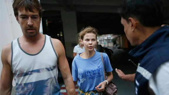 Anastasia Vashukevich, center, and Alexander Kirillov, left, arrive at the immigration detention center in Bangkok, Thailand, Wednesday, Feb. 28, 2018, after being arrested Sunday in the Thai resort city of Pattaya.