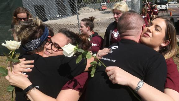 Parents and students of Marjory Stoneman Douglas High School Parkland, Fla., and community members receive a warm welcome as they stop at the site of the Pulse nightclub attack in Orlando, Fla., on Wednesday, Feb. 28, 2018, on their way back home from Tallahassee. (Red Huber/Orlando Sentinel/TNS via Getty Images)