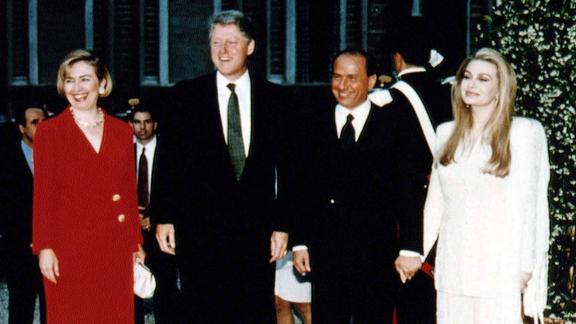 US President Bill Clinton and first lady Hillary Clinton meet Berlusconi and his wife, Veronica Lario, during an official visit to Rome in June 1994.