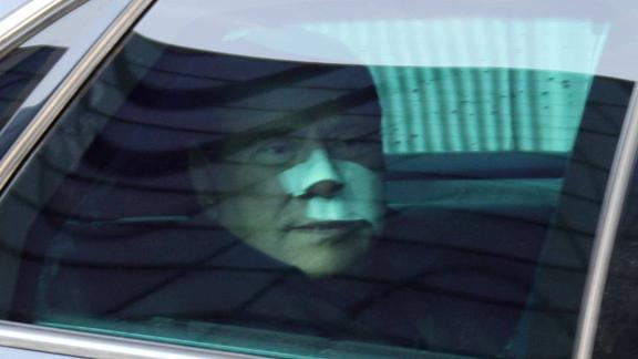 Berlusconi leaves a hospital in Milan in December 2009, following treatment for injuries he received during a campaign rally. A man wielding a model of Milan's cathedral attacked Berlusconi during the rally, breaking his nose and some of his teeth.