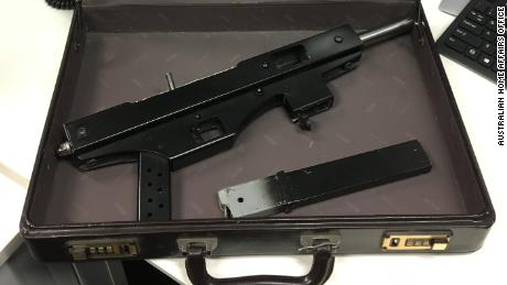 Surrendered items included this homemade machine gun in a suitcase.
