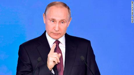 Russian President Vladimir Putin gestures as he gives his annual state of the nation address in Manezh in Moscow, Russia, Thursday, March 1, 2018. Putin set a slew of ambitious economic goals, vowing to boost living standards, improve health care and education and build modern infrastructure in a state-of-the-nation address. (Alexei Nikolsky, Sputnik, Kremlin Pool Photo via AP)