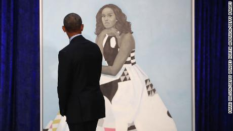 WASHINGTON, DC - FEBRUARY 12:  Former U.S. President Barack Obama looks at former first lady Michelle Obama's newly unveiled portrait during a ceremony at the Smithsonian's National Portrait Gallery, on February 12, 2018 in Washington, DC. The portraits were commissioned by the Gallery, for Kehinde Wiley to create President Obama's portrait, and Amy Sherald that of Michelle Obama.  (Photo by Mark Wilson/Getty Images)