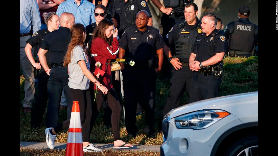 "Students and staff members from Marjory Stoneman Douglas High School were greeted by police and well-wishers as they returned to the school in Parkland, Florida, on Wednesday, February 28. It was <a href=""https://www.cnn.com/interactive/2018/02/us/florida-school-shooting-return-cnnphotos/index.html"" target=""_blank"">their first day back</a> since a mass shooting at the school killed 17 people on February 14."