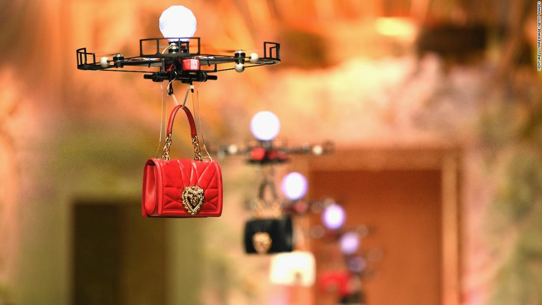 A drone carries a handbag down the runway at a Dolce & Gabbana fashion show in Milan, Italy, on Sunday, February 25.