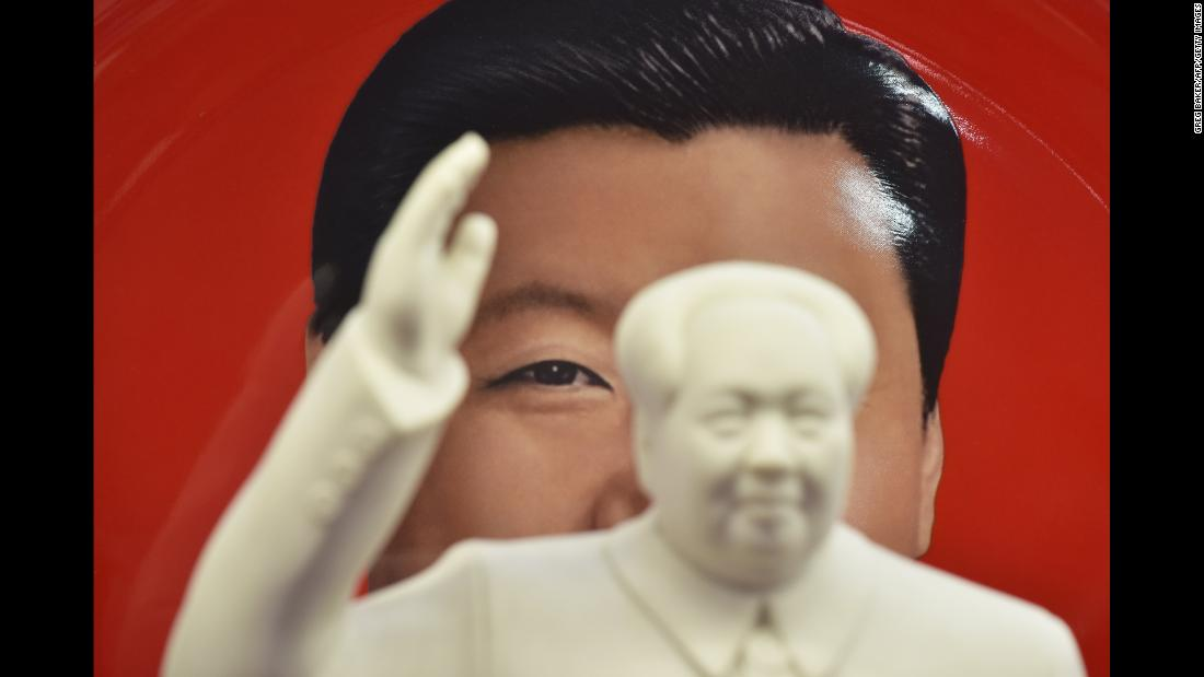 "A decorative plate featuring an image of Chinese President Xi Jinping is seen behind a statue of late Communist leader Mao Zedong at a souvenir store in Beijing on Tuesday, February 27. China's Communist Party has proposed amending the country's constitution <a href=""https://www.cnn.com/2018/02/25/asia/china-communist-party-xi-jinping-intl/index.html"" target=""_blank"">to get rid of presidential term limits. </a>"