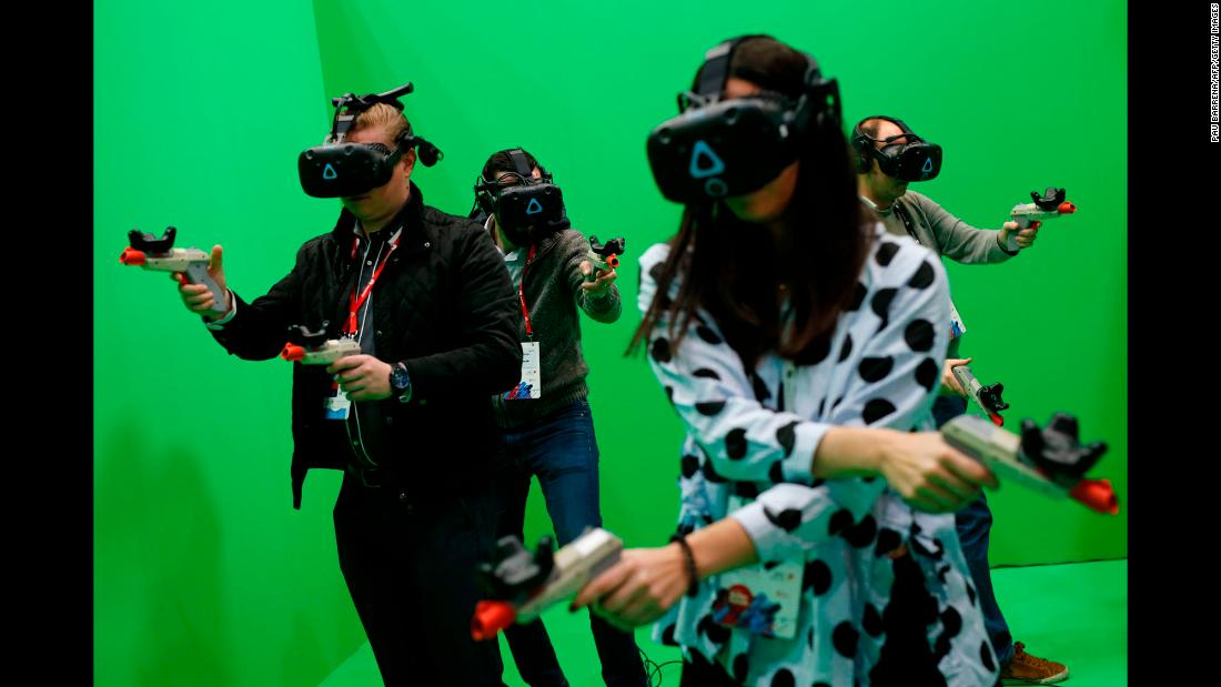 People try out virtual reality headsets during the Mobile World Congress, the world's biggest mobile fair, on Monday, February 26. The event was held in Barcelona, Spain.