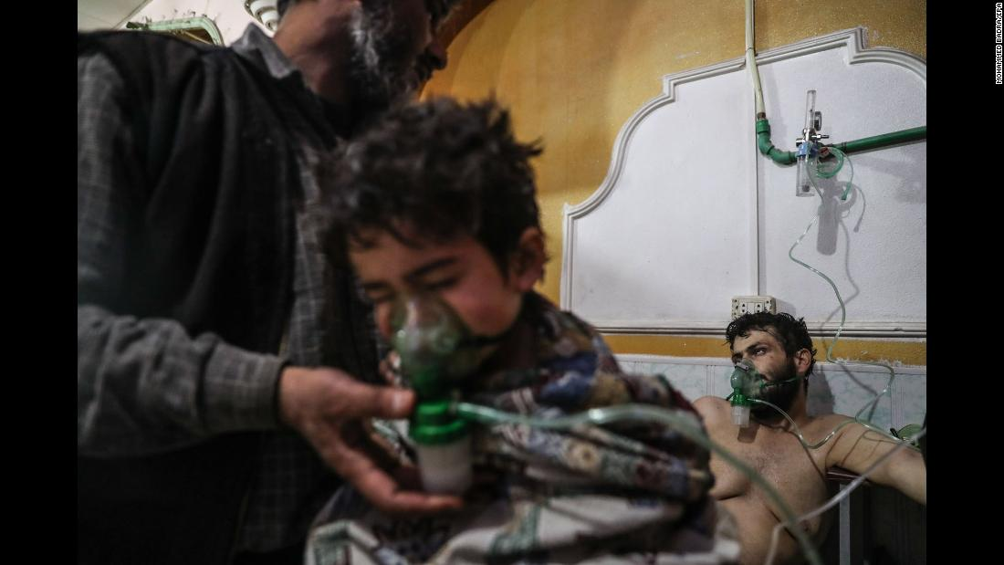 "A child receives medical treatment after a village was attacked in Syria's rebel-held Eastern Ghouta region on Sunday, February 25. Several people were treated for exposure to chlorine gas, opposition groups said, <a href=""https://www.cnn.com/2018/02/26/middleeast/syria-ceasefire-violation-ghouta-intl/index.html"" target=""_blank"">as airstrikes and artillery fire from the regime continued.</a> CNN was unable to independently verify claims that chlorine was used as a weapon."