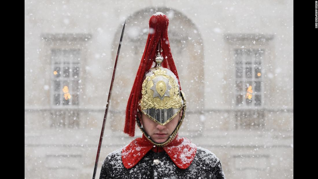 "Heavy snow falls on a Household Cavalry guard in London on Wednesday, February 28. Britain was hit by heavy snow and subzero temperatures Wednesday as the <a href=""https://www.cnn.com/2018/02/28/europe/uk-weather-snow-intl/index.html"" target=""_blank"">""Beast from the East""</a> brought chaos to the country's infrastructure. The cold snap, which has chilled much of Europe, left Britain blanketed in snow."