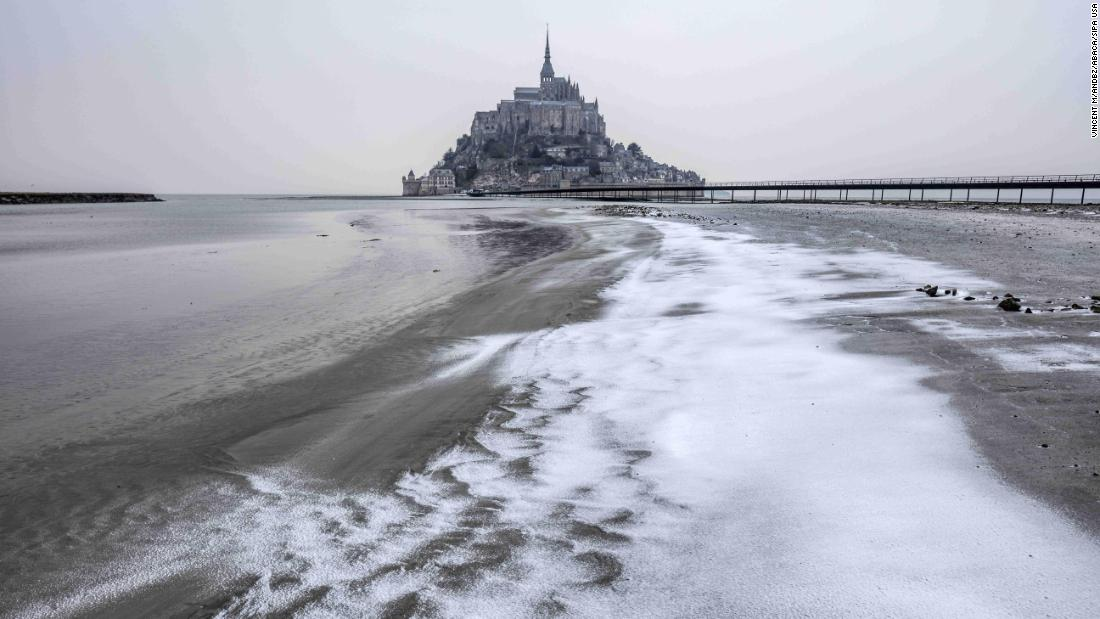 Snow covers Mont Saint-Michel, an island commune in France, on Thursday, March 1.
