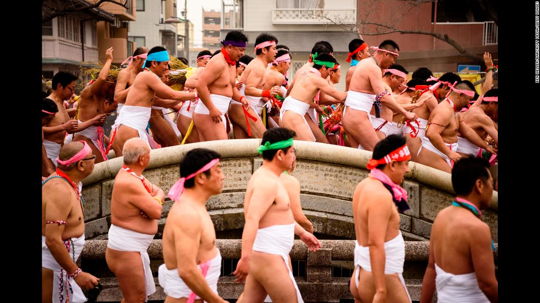 Men participate in the Konomiya Naked Festival in Inazawa, Japan, on Wednesday, February 28. The annual festival started in the year 767. Thousands of men march through the streets wearing only loincloths. The event is meant to drive away evil spirits and bring in good luck.