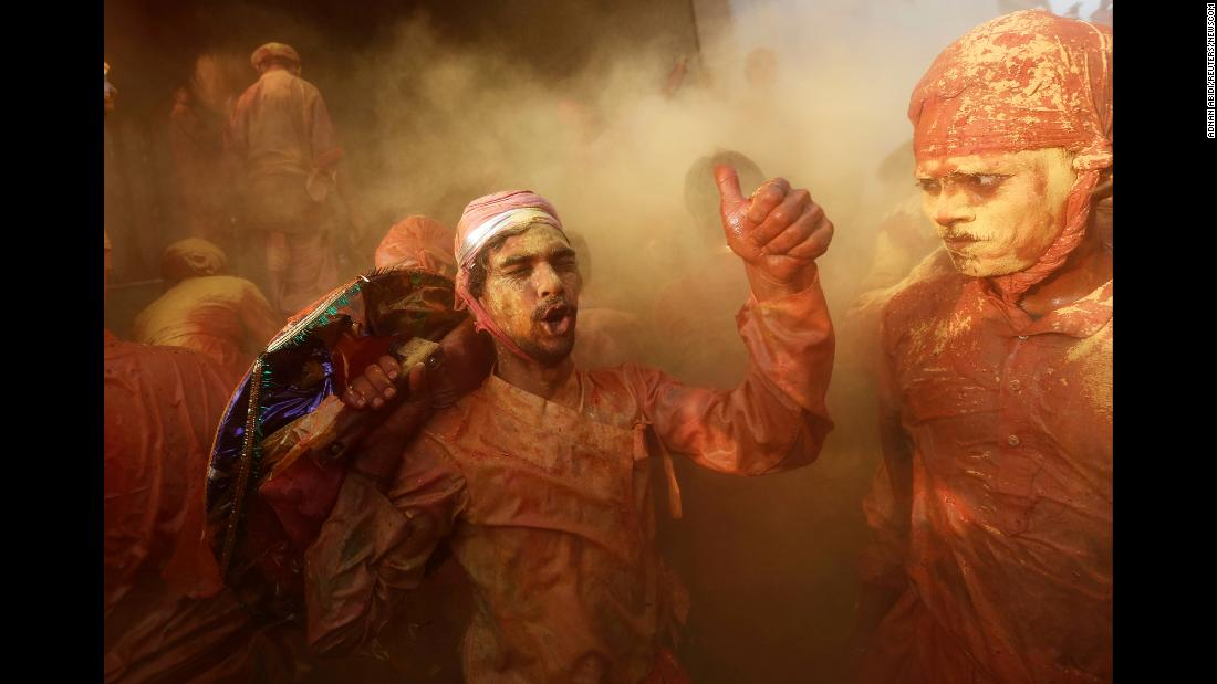 Hindu devotees in India's Nandgaon village take part in the religious festival of Holi on Sunday, February 25. Holi marks the welcoming of spring and is a celebration of the triumph of good over evil, with people playfully splashing colorful paint, powder and water on one another.