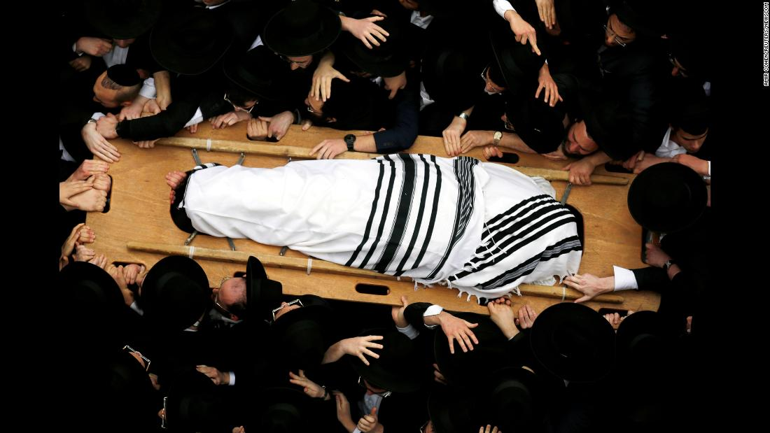 Ultra-Orthodox Jewish men carry the body of Rabbi Shmuel Auerbach, head of a denomination known as the Jerusalem Faction, during his funeral on Sunday, February 25.