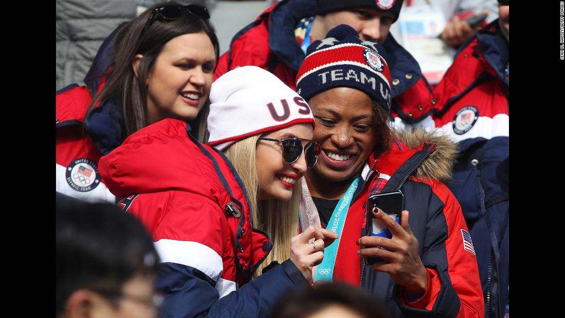 Ivanka Trump, daughter and senior adviser to US President Donald Trump, interacts with American athlete Lauren Gibbs as they attend the four-man bobsled event at the Winter Olympics on Sunday, February 25. Trump attended the closing ceremony later that day. Gibbs won silver in the two-woman bobsled last month.