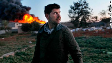 MISRATA, LIBYA - APRIL 18: Getty Images photographer Chris Hondros stands in front of a burning building while on assignment on April 18, 2011, in Misrata, Libya. Hondros, who was on assignment in Misrata, Libya, was killed on April 20, 2011 by a rocket-propelled grenade (RPG). (Photo by Katie Orlinsky via Getty Images)