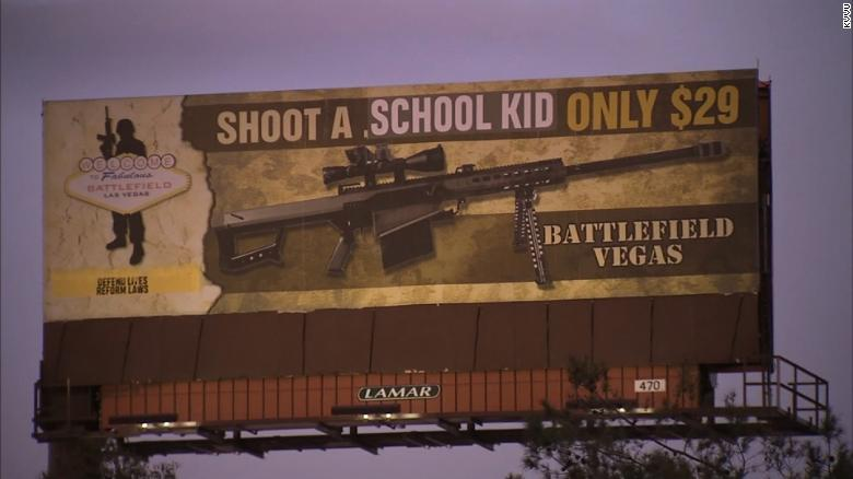 Defaced billboard: 'Shoot a school kid only $29'