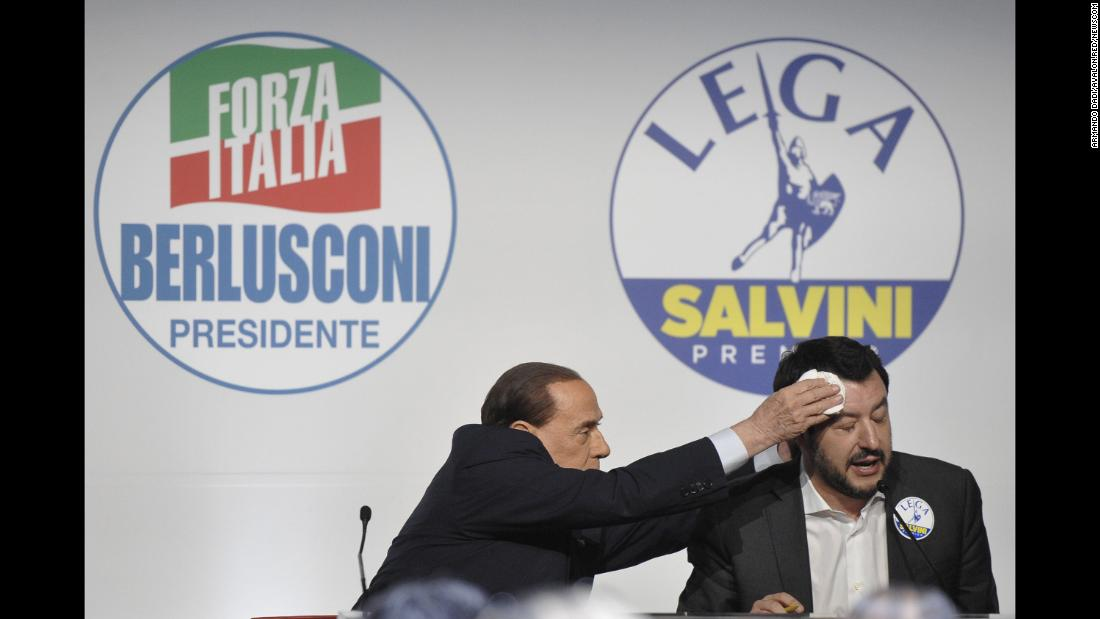"Former Italian Prime Minister Silvio Berlusconi, president of the Forza Italia party, wipes the forehead of Matteo Salvini, federal secretary of the Lega Nord party, during a news conference on Thursday, March 1. The center-right alliance brokered by Berlusconi looks set to take the largest share of the vote as <a href=""https://www.cnn.com/2018/02/28/europe/silvio-berlusconi-italy-elections-intl/index.html"" target=""_blank"">Italian voters head to the polls on Sunday.</a>"