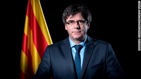 Exiled former Catalan leader Carles Puigdemont poses in front of a Catalan flag during a photo session in Brussels on February 7, 2018.  / AFP PHOTO / Emmanuel DUNAND        (Photo credit should read EMMANUEL DUNAND/AFP/Getty Images)
