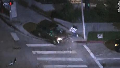 A wild chase that started in Beverly Hills ended in a violent crash that nearly took out a freelance news photographer.      The chase of a suspected stolen car started just before 11 p.m. Tuesday in the area of Wilshire and La Cienega boulevards and ended about three minutes later at Wilshi re and Crenshaw boulevards.      The driver struck another vehicle stopped at a red light, and ricocheted into the crosswalk, where Loud Labs News photographer Victor Park had been standing. Park ran out of the way and just narrowly missed being taken out by the car as it swerved onto the sidewalk.