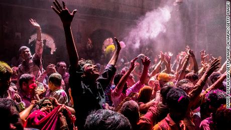 Hindu devotees play with color during Holi celebrations at the Banke Bihari temple on March 27, 2013 in Vrindavan, India.