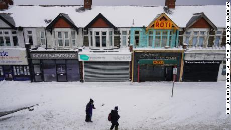 "CARDIFF, UNITED KINGDOM - MARCH 02:  The streets are deserted and shops and businesses remain closed on Eastern Avenue, as Storm Emma and the 'Beast form the East hit South Wales on March 2, 2018 in Cardiff, United Kingdom. Freezing weather conditions dubbed the ""Beast from the East"" combines with Storm Emma coming in from the South West of Britain to bring further snow and sub-zero temperatures causing chaos on roads and shutting schools. Red weather warnings for snow have been seen in the UK for the first time and five people have died as a result.  (Photo by Christopher Furlong/Getty Images)"