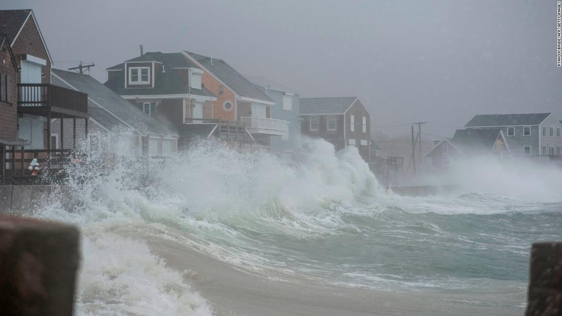 "Waves crash against homes in Scituate, Massachusetts, on Friday, March 2. A powerful nor'easter morphed into a ""bomb cyclone,"" bringing rain, snow and heavy winds to parts of the East Coast."