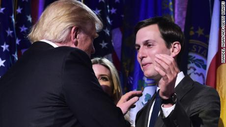 Republican presidential nominee Donald Trump shakes hands with son-in-law Jared Kushner (R) during an election night party at a hotel in New York on November 9, 2016. / AFP / MANDEL NGAN        (Photo credit should read MANDEL NGAN/AFP/Getty Images)