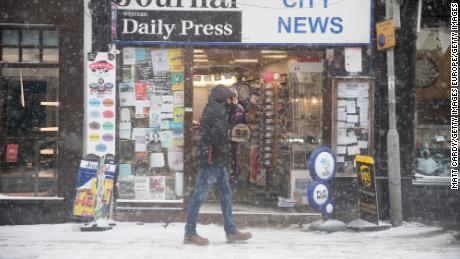 "WELLS, UNITED KINGDOM - MARCH 01:  People walk around the near empty main shopping street as the forecasted snow arrives in Wells on March 1, 2018 in Somerset, England. Freezing weather conditions dubbed the ""Beast from the East"" combines with Storm Emma coming in from the South West of Britain to bring further snow and sub-zero temperatures causing chaos on roads and shutting schools. Red weather warnings for snow have been seen in the UK for the first time and five people have died as a result.  (Photo by Matt Cardy/Getty Images)"