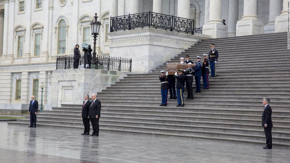 Graham's casket is carried down the East Steps of the US Capitol on March 1.