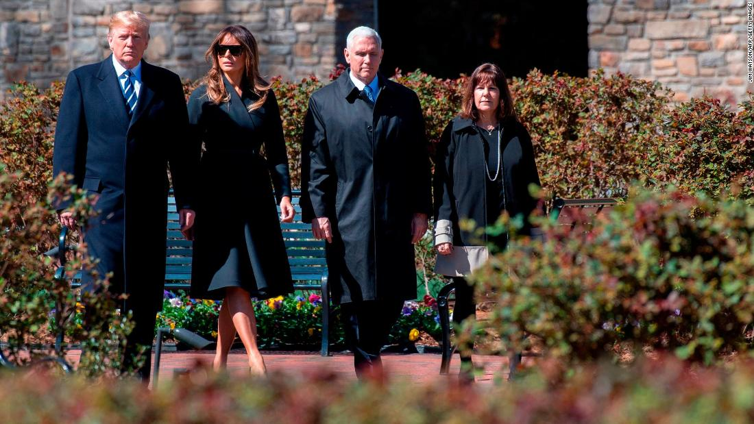 US President Donald Trump arrives at the funeral with his wife, Melania; Vice President Mike Pence; and Pence's wife, Karen.