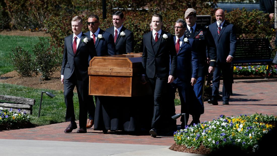 Graham's casket is carried to his funeral service.