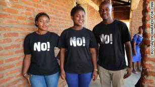 Instructors Simang'aliso Domoya, left, Patricia Mvula, center, and Dominc Luo, right, outside the Lilongwe classroom.