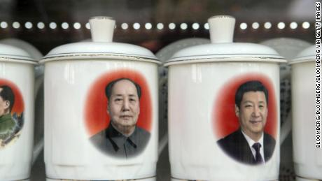 Porcelain cups featuring portraits of Chinese President Xi Jinping, right, and former Chinese leader Mao Zedong stand on display at a store window in Beijing, China, on February 26.