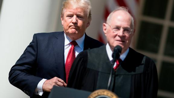 President Donald Trump listens while Supreme Court Justice Anthony Kennedy speaks during a ceremony in the Rose Garden of the White House April 10, 2017 in Washington, DC.