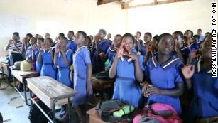 Girls repeat Domoya's chant: