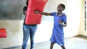 Ujamaa-Pamodzi instructors teach the girls self-defense, and how to say: