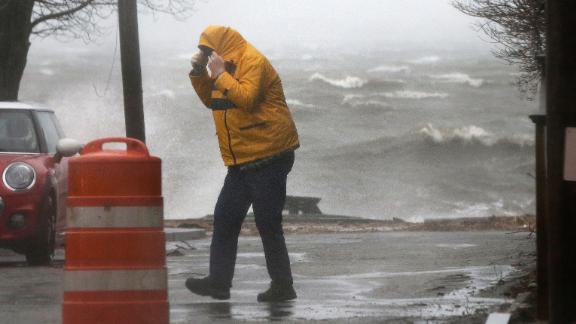 A pedestrian braves the harsh weather conditions near the coast in Newburyport, Massachusetts, on March 2.