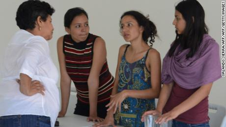 Daughters of murdered indigenous activist Berta Caceres, Olivia Marcela (2-L), Berta Isabel (2-R) and Laura Zuniga Caceres (R), are seen before a press conference in Tegucigalpa on March 9, 2016. Honduran indigenous activist Berta Caceres, a renowned environmentalist whose family has labeled her killing an assassination, was shot dead on March 3 at her home in La Esperanza. Caceres rose to prominence for leading the indigenous Lenca people in a struggle against a hydroelectric dam project that would have flooded large areas of native lands and cut off water supplies to hundreds.  AFP PHOTO /Orlando SIERRA. / AFP / ORLANDO SIERRA        (Photo credit should read ORLANDO SIERRA/AFP/Getty Images)