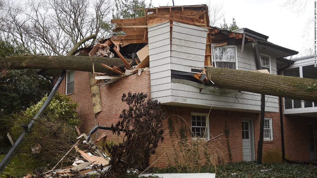 A large tree pierces a house in the Washington suburb of Kensington, Maryland, on March 2.