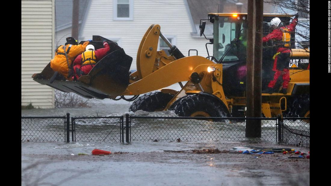 Rescue crews secure residents in the bucket of a front end loader in the Boston suburb of Quincy on March 2.
