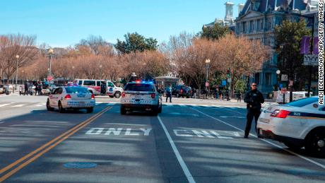 "The White House is on lockdown following an incident with a gun on the North side in Washington, DC March 3, 2018. The White House was placed on lockdown and the surrounding area cordoned off by emergency personnel Saturday after an apparent gunshot was heard. The US Secret Service said on Twitter that it was responding ""to reports of a person who allegedly suffered a self-inflicted gunshot wound along the north fence line of @White House."" It said medical personnel were ""responding to the male victim,"" but that there were ""no other reported injuries."" The victim's identity was not immediately known.  / AFP PHOTO / Alex Edelman        (Photo credit should read ALEX EDELMAN/AFP/Getty Images)"
