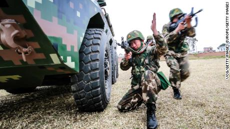 Chinese troops particpate in an anti-riot armored-vehicle training exercise on February 10, 2018, Yunnan province.