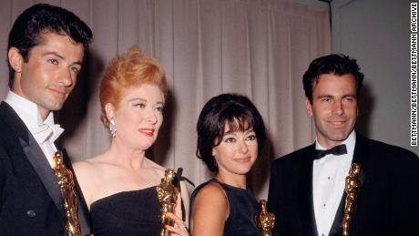 (L-R) George Chakiris, Greer Garson, Rita Moreno and Maximilian Schell pose with their Oscars at the 1962 Academy Awards.