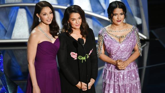 Ashley Judd, Annabella Sciorra and Salma Hayek speak onstage during the 90th Annual Academy Awards.