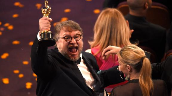 """Guillermo del Toro, winner of the award for best director for """"The Shape of Water"""" celebrates in the audience at the Oscars on Sunday, March 4, 2018, at the Dolby Theatre in Los Angeles. (Photo by Chris Pizzello/Invision/AP)"""