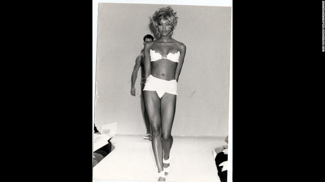 Supermodel Naomi Campbell walks the runway in 1989. During this era, slender yet strong supermodels became idealized images of beauty.<br />
